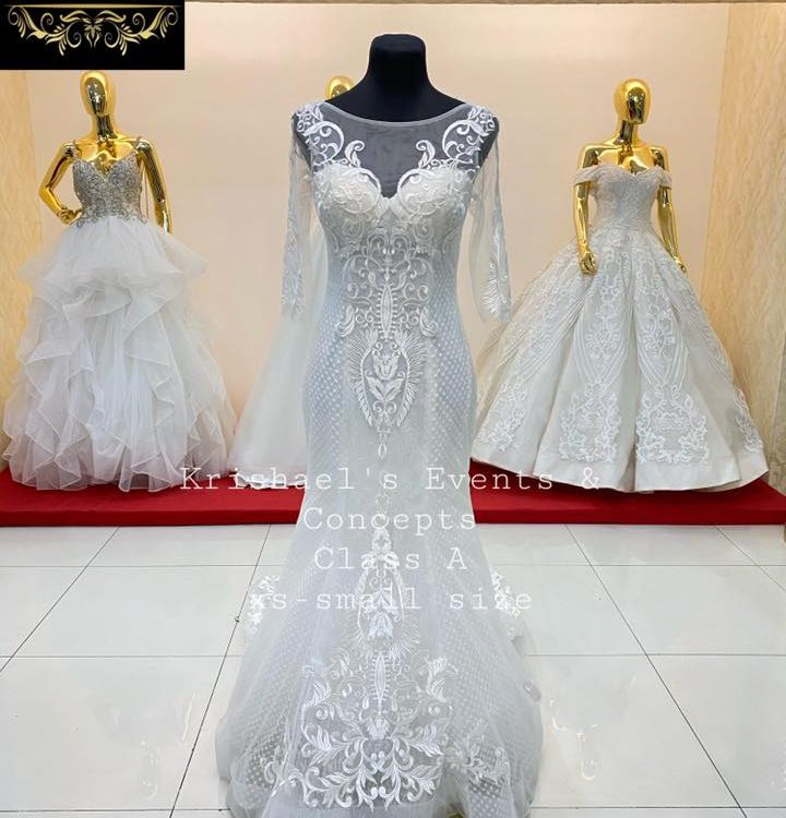 New Arrival Class A 3/4 sleeves Wedding Gown available for first user rent or fo...